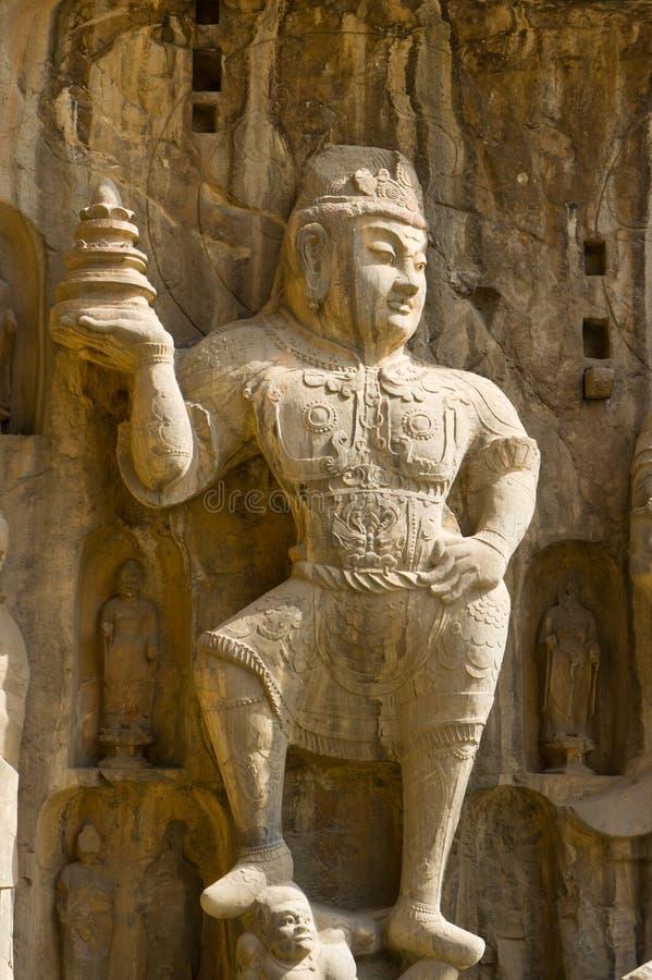 Stone statue of a heavenly king in the Longmen Gro