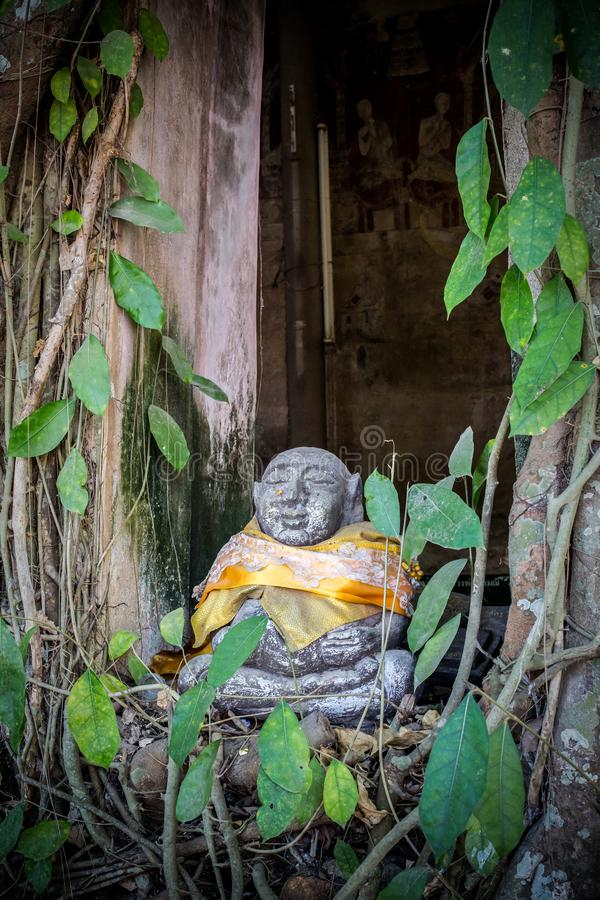 Stone Statue of Katyayana or Phra Sangkajai on Window Katyayana was a disciple of Gautama Buddha at Wat Bang Kung - Samut royalty free stock photography