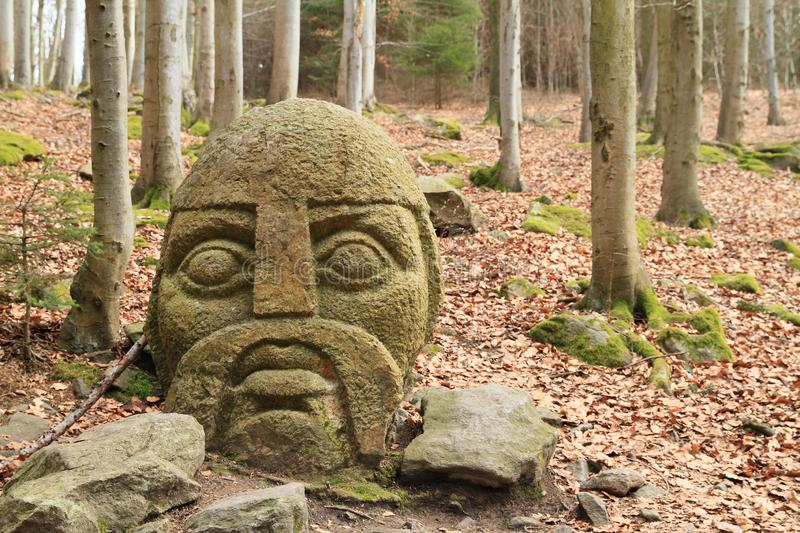 Stone statue of Knight of Blanik in forest on hill Great Blanik stock photography