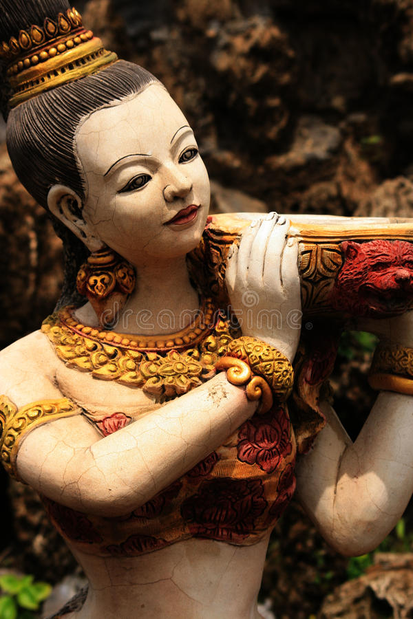 Stone statue of a lady, Thailand. Stone statue of a lady carrying water, garden ornament, Thailand stock images