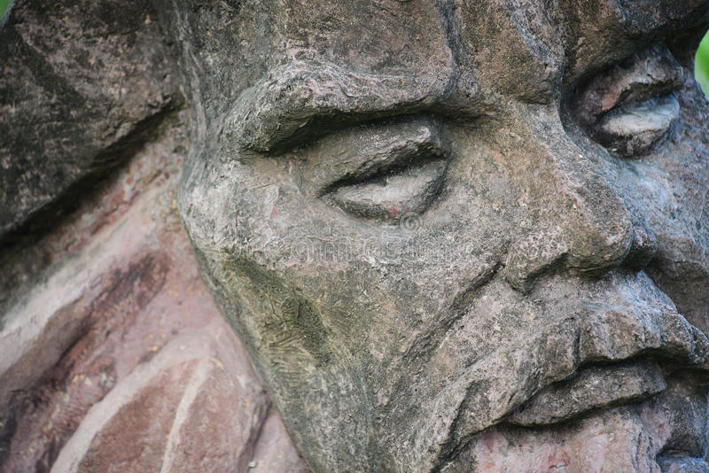 Stone statue of old man's face royalty free stock image
