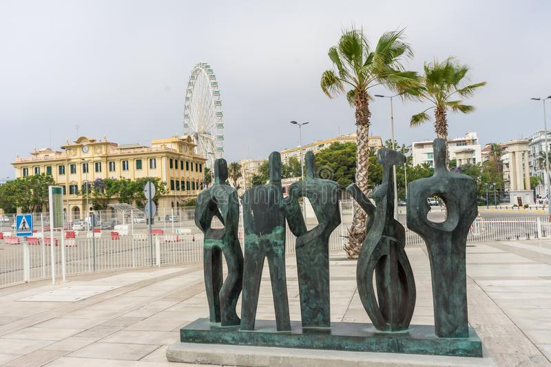 Stone statue sculpture overlooking the giant wheel in the city o stock photo