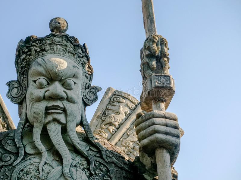 Stone statue in Wat Phra ChetuphonWat Pho of Thailand. Chinese giant stock image