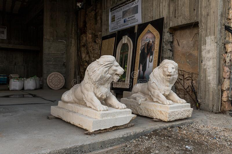Stone statues of lions are for sale near the entrance to the building in Bethlehem in Palestine stock photo