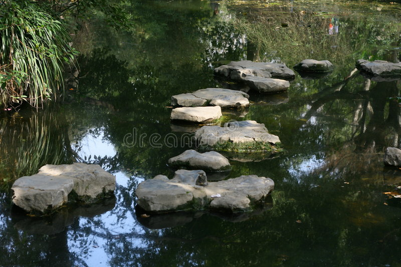 Stone step on the streamlet stock images
