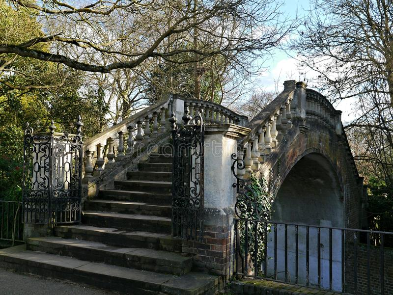 Stone Gothic Style Bridge in Twickenham London Uk. A stone stepped bridge in gothic style leading from york house gardens to the river thames in twickenham royalty free stock images