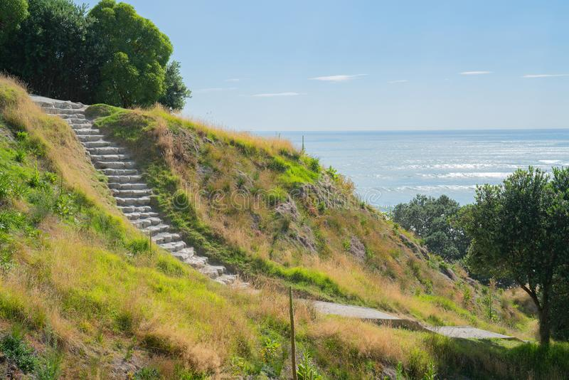 Stone steps down track up Mount Maunganui with view beyond to Pacific Ocean. At Tauranga New Zealand stock image