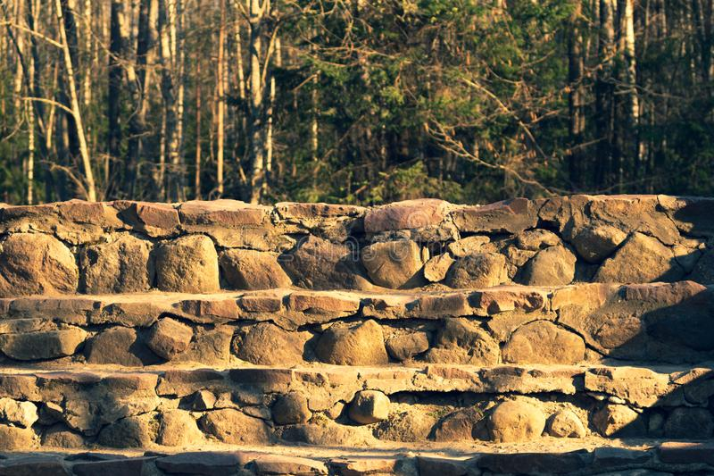 Stone steps ladder. stairs from natural stones in the park stock image
