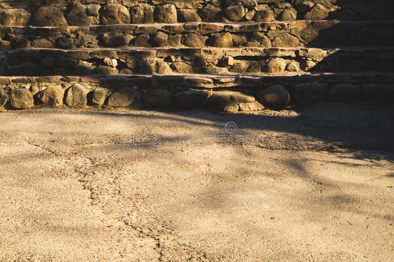 Stone steps ladder. stairs from natural stones in the park background stock image