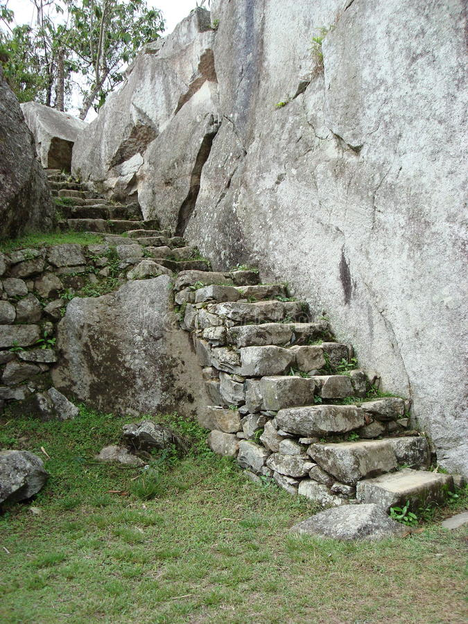 Stone steps at Machu Picchu. A wall of stone steps in the interior of Machu Picchu in Peru royalty free stock images