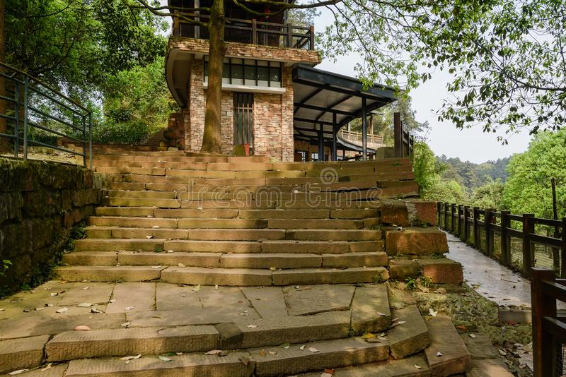 Stone steps before 2-story building for sightseers in sunny spring afternoon. Stone steps before a 2-story building for sightseers in sunny spring afternoon royalty free stock photo