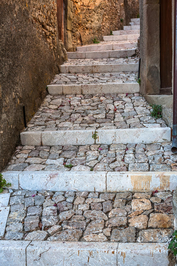 Stone steps to rustic house in old city royalty free stock photo