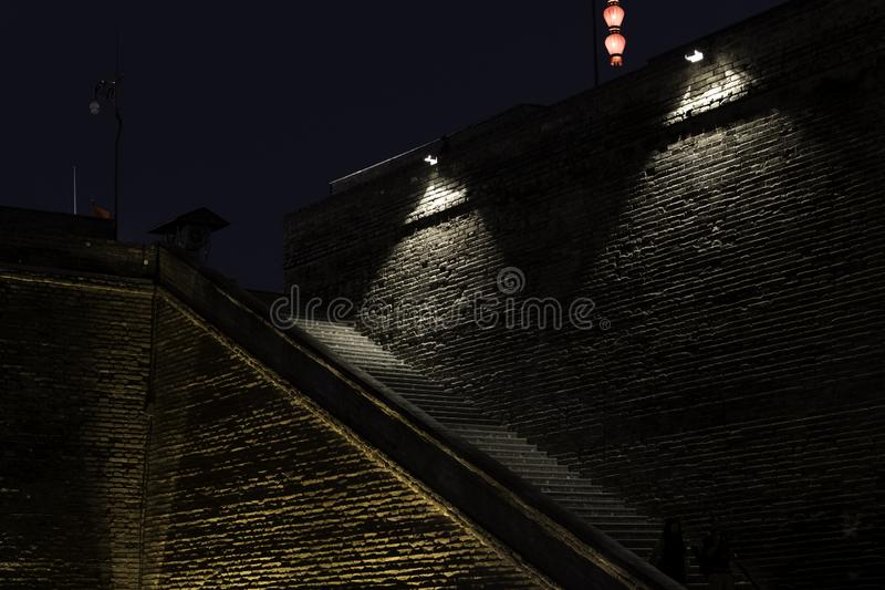 Stone steps up stone wall historic night dark poor lighting creepy sinister stock images