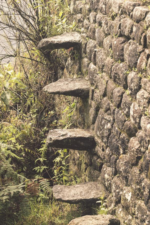 Stone steps wall. Inbuild stone steps ladder in terrace wall at Machu Picchu site in Peru royalty free stock photo