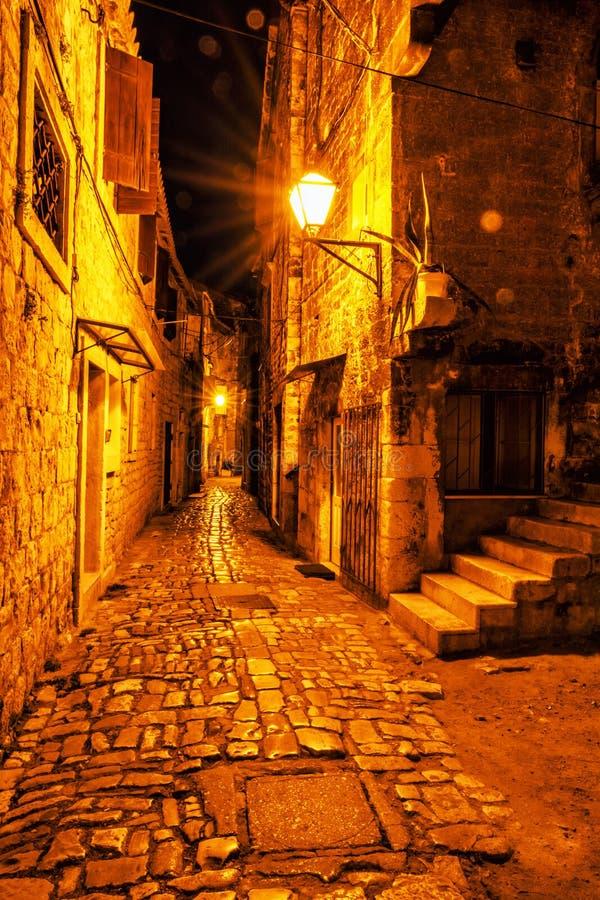 Stone street in Trogir, Croatia, night scene royalty free stock photo