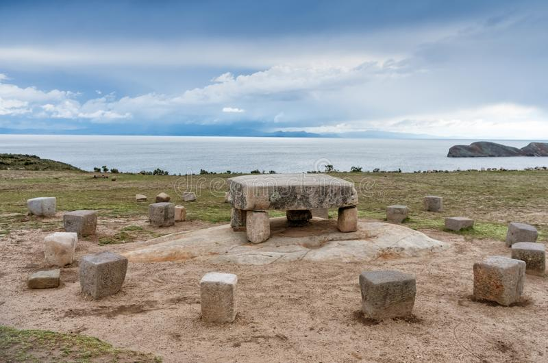 Stone table - sacrificial altar, ruins on the Island of Sun (Isla del Sol) on Titicaca lake in Bolivia royalty free stock images