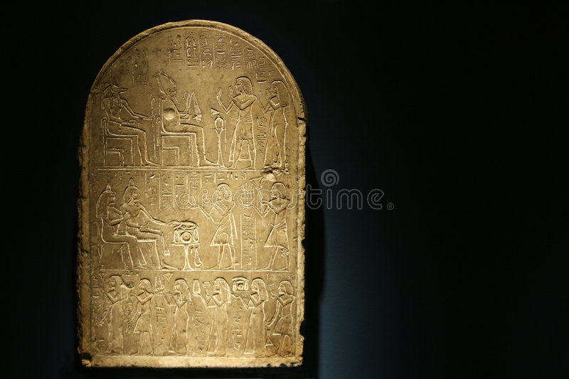Stone Tablet with Hieroglphics. A stone tablet with heiroglyphics telling a story royalty free stock images
