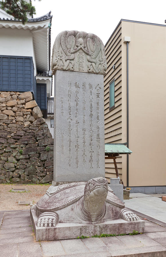 Stone with teachings in Okazaki Castle, Japan. Stone with teachings of deified in Shinto shogun Tokugawa Ieyasu in Okazaki castle. Castle was founded in 1455 by royalty free stock image