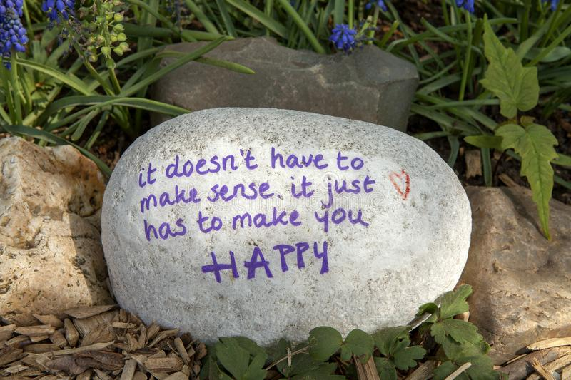 Stone with text. It doesn't have tot make sense, it just has to make you happy in nature stock photography