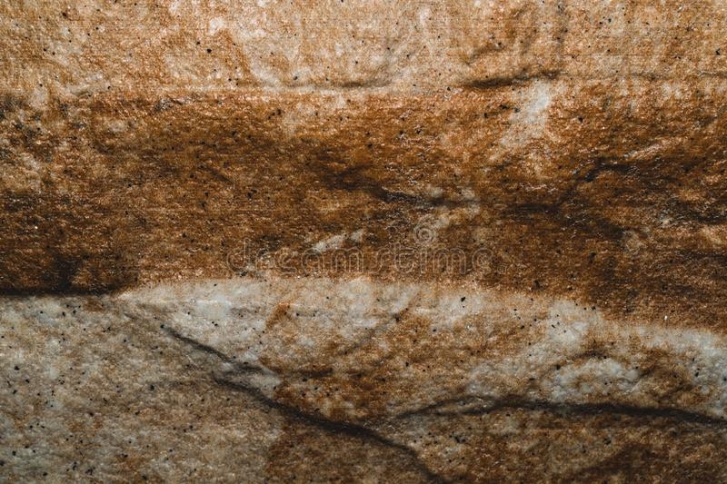 Brown stone with cracks on the surface. Stone texture background close up. brown stone with cracks on the surface, rock, granite, nature, rough, ancient, marble royalty free stock image