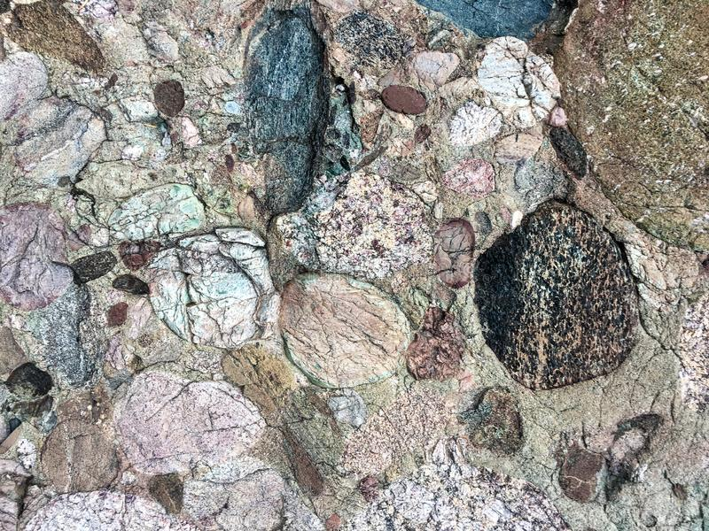 Stone textured background with different shapes and colors. A homogenous rock texture background with varied textures and colors stock image