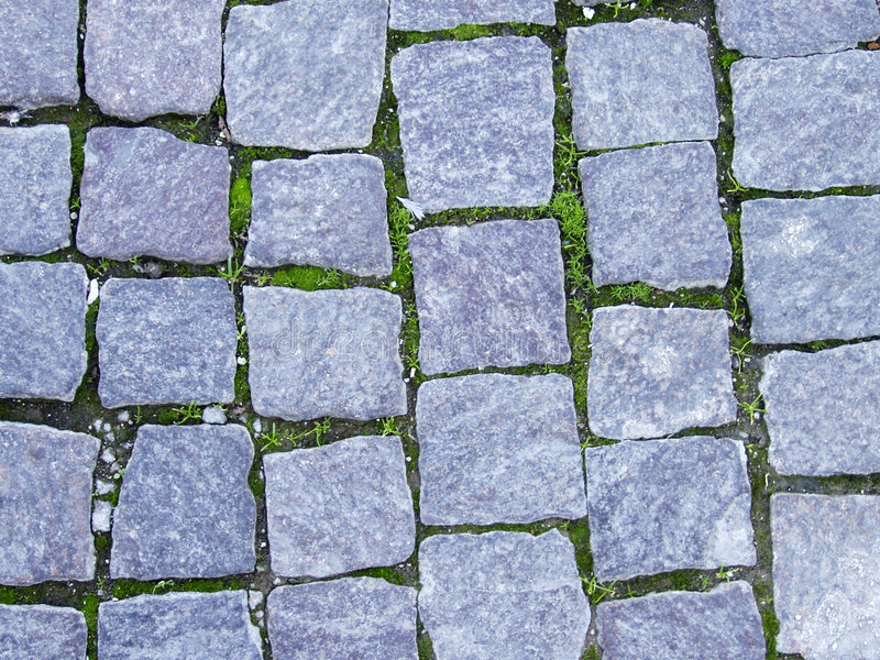 Stone tiles. Grey stone tiles bobblestone pavement stock image
