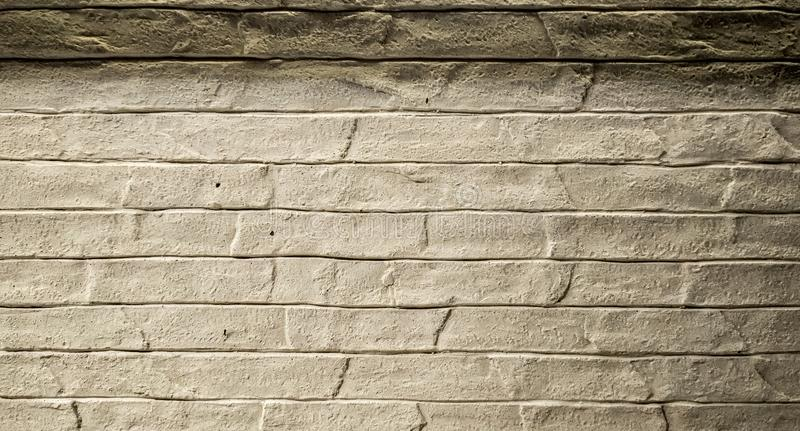 Stone tiles cladding for a wall of grey color and texture. With some light can be also used as a background stock photography