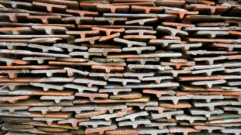 Stone tiles of different shades are stacked in a large pile. Background image. Building material. royalty free stock photos