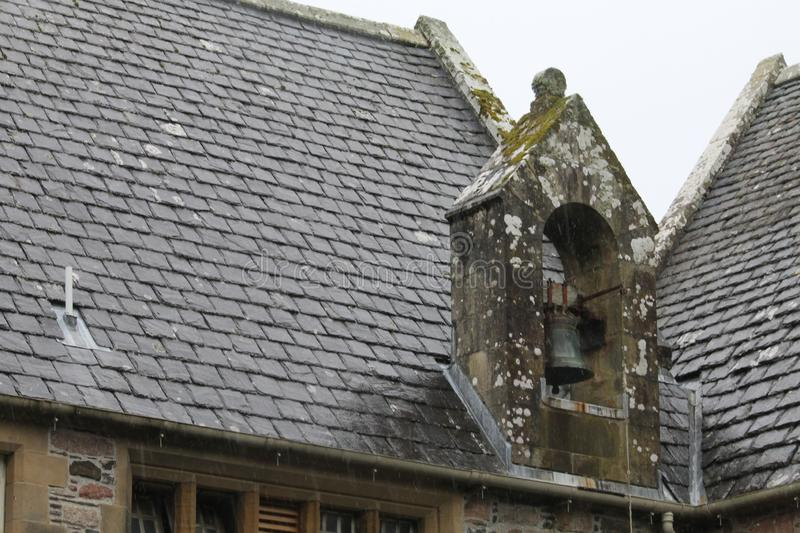 Stone tiles of roof of old church stock photo