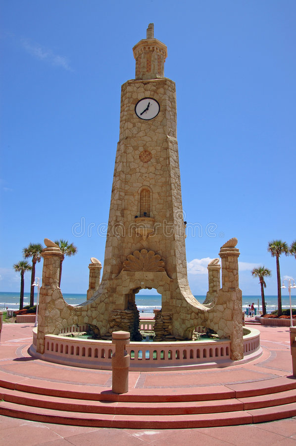 Stone tower with clock. Beautiful stone tower with clock on the beach in Daytona, Florida royalty free stock images