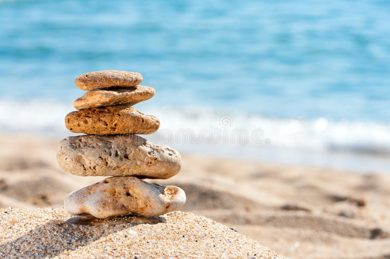 Download Stone Tower In Sand Against Sea. Stock Photo - Image: 21004622