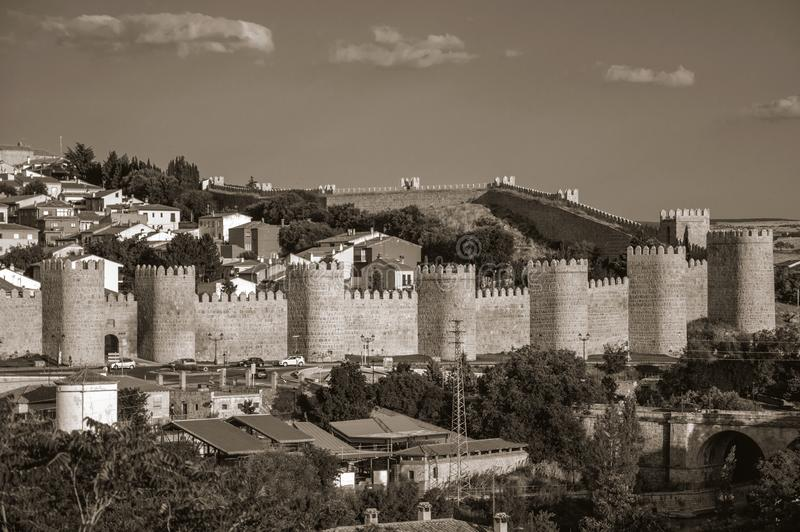 Stone towers on large wall over the hill encircling Avila stock photography