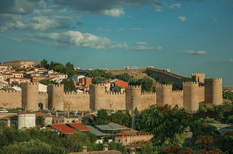 Stone towers on large wall over the hill encircling Avila royalty free stock photos