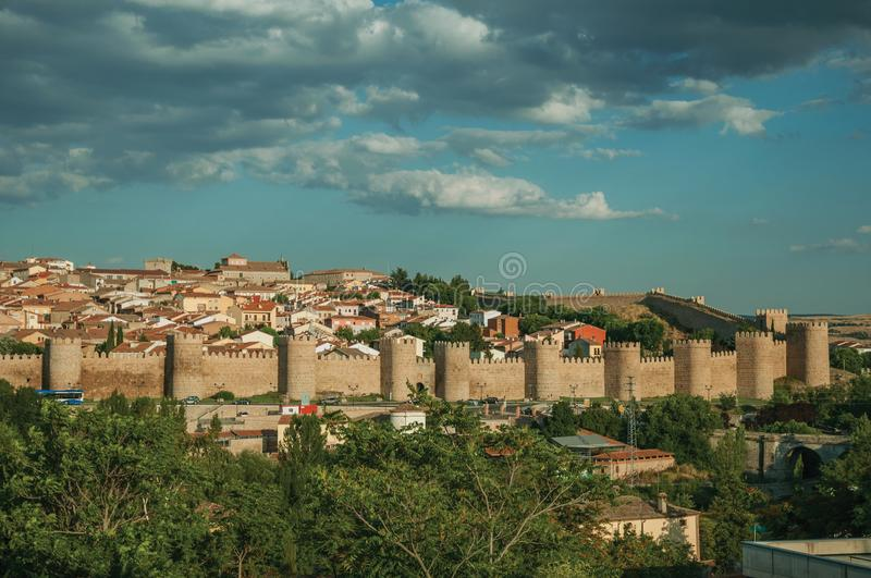 Stone towers on large wall over the hill encircling Avila royalty free stock photography