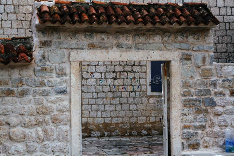 Stone Town. Entrance to the courtyard, decorated with tiles. stock photography