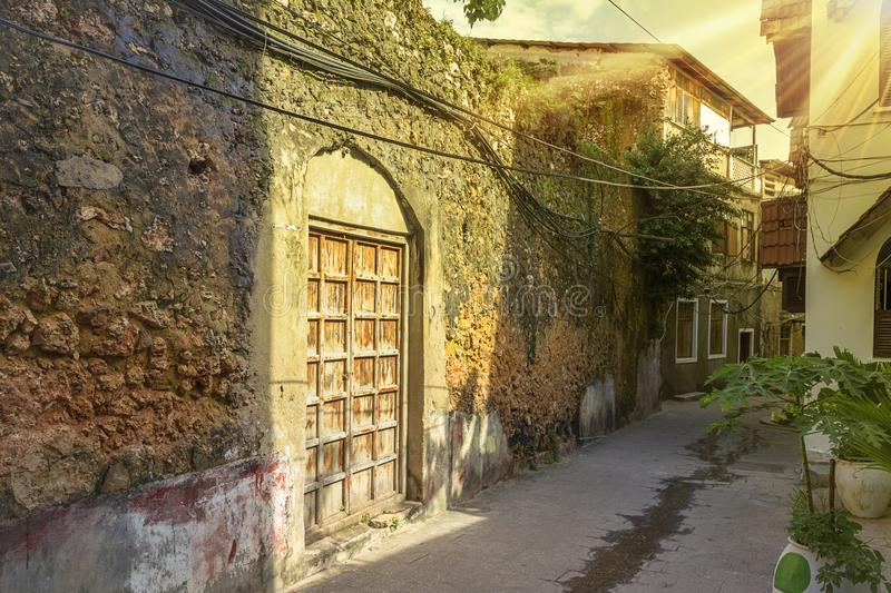 Stone town streets and alley-ways with sunburst. Urban and city life and buildings with sunburst on a doorway in the rustic streets and alley-ways of the old stock image
