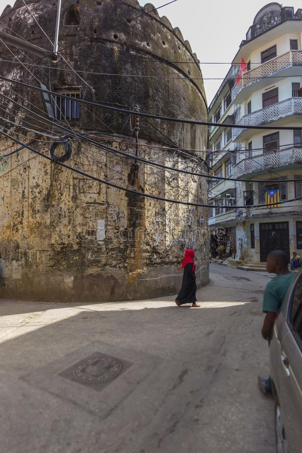 Stone town streets and alley-ways. Urban and city life and buildings of the rustic streets and alley-ways of the old town on zanzibar island stone town royalty free stock photography