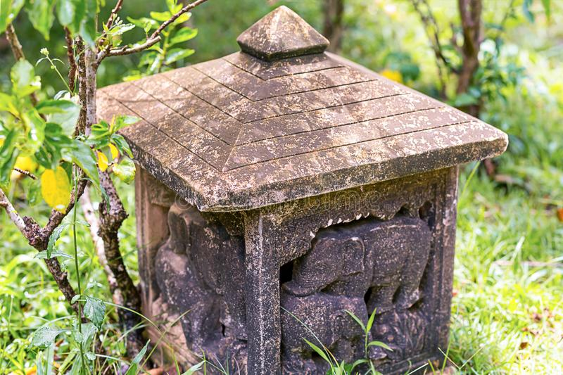 Stone traditional lantern carved ornamental elephant weathered with pyramidal roof stock image