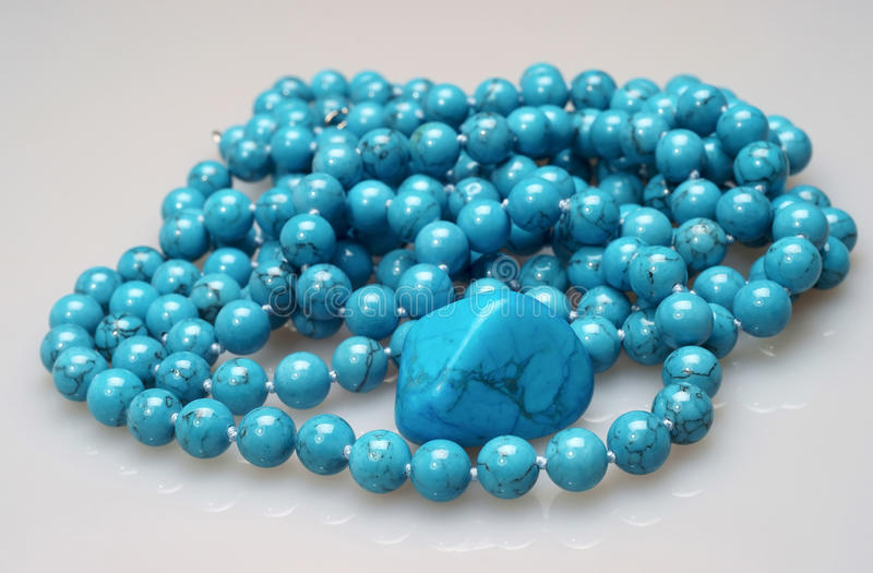 Stone turquoise and a beads royalty free stock images
