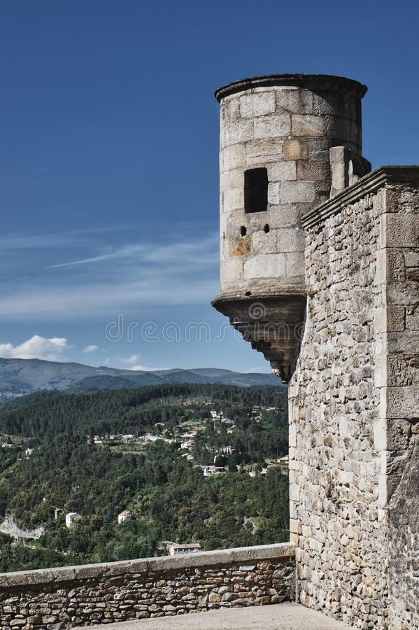 The stone turret and walls of the medieval castle. Of Aubenas in France stock images