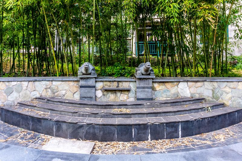 Stone Turtles Sculptures. China Two Stone Turtles Sculptures with Bamboo Trees Background Nobody stock images