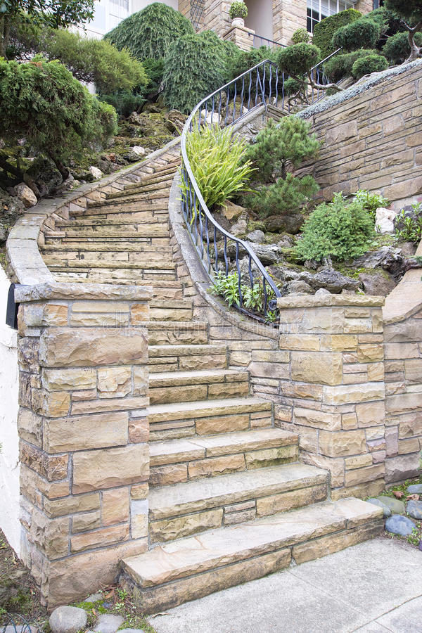 Stone Veneer Facade on Home Exterior Staircase. Stone Veneer Faccade on Home Exterior Staircase with Manicured Front Entrance Yard Landscape stock photo
