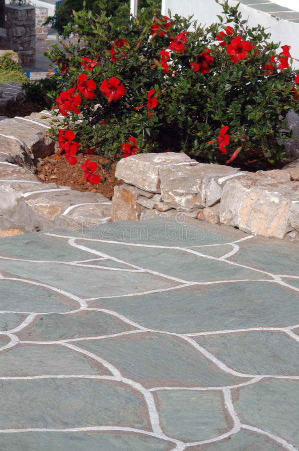 Stone walkway with flowers royalty free stock images