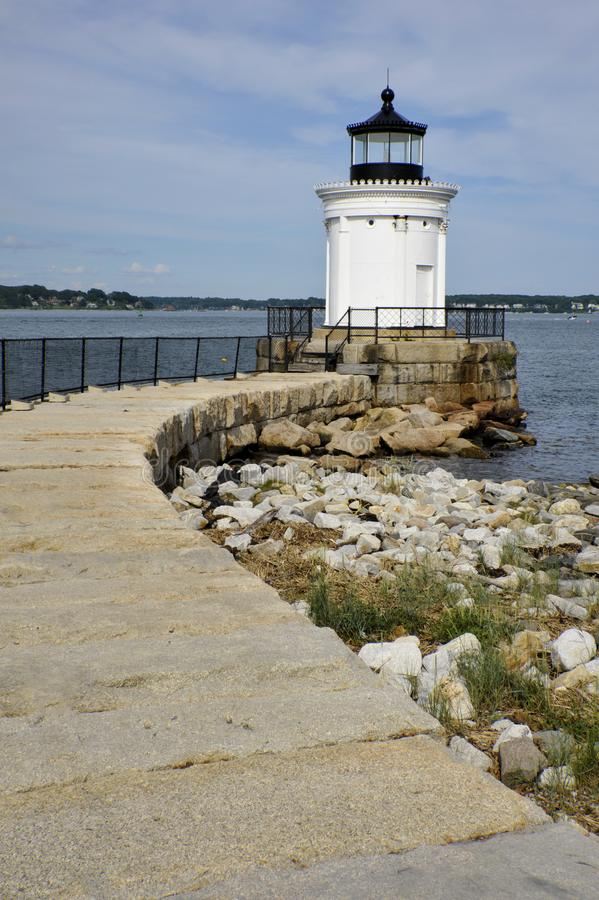 Stone Walkway Leads to Maine Lighthouse stock image