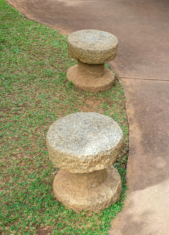 Stone walkway and stone bench in the park royalty free stock photography