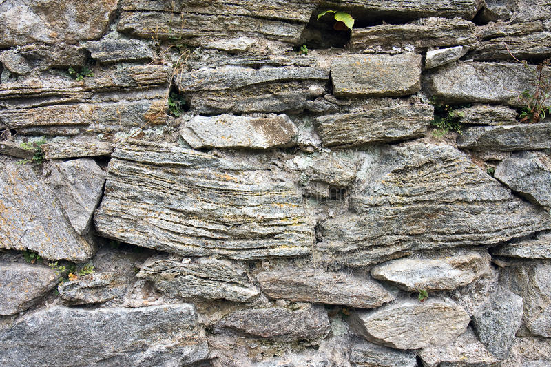 Stone wall. Texture of the old stone wall stock images