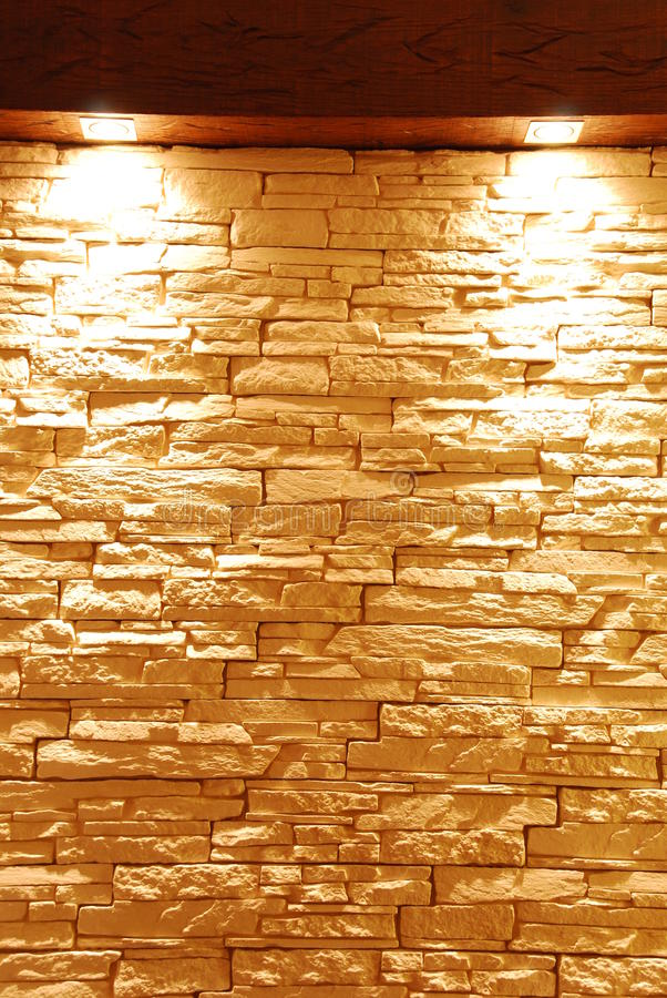 Stone wall. Gray and unshaped stone wall with spot lights royalty free stock photos
