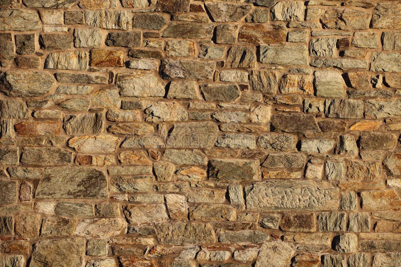 Stone Wall. Wall made out of stone in the afternoon mild autumn light royalty free stock photos