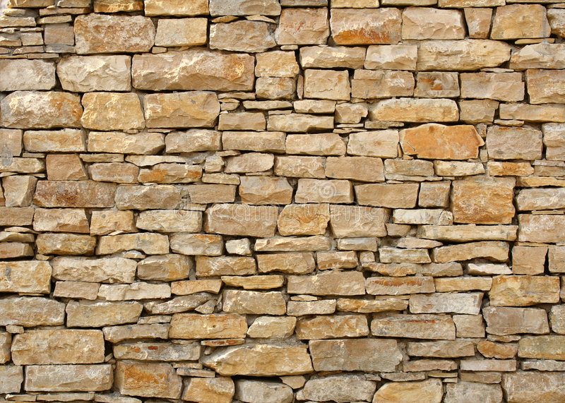 Stone wall. A photo of a stone wall stock photo