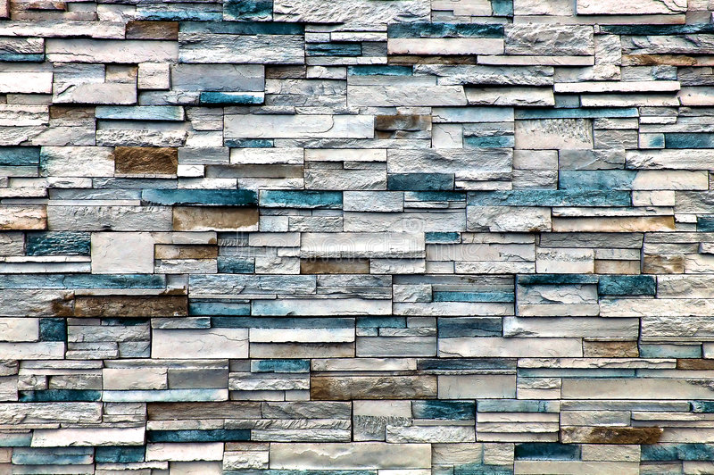 Stone Wall. A stone wall with mainly white and blue bricks, but some few are brown stock image